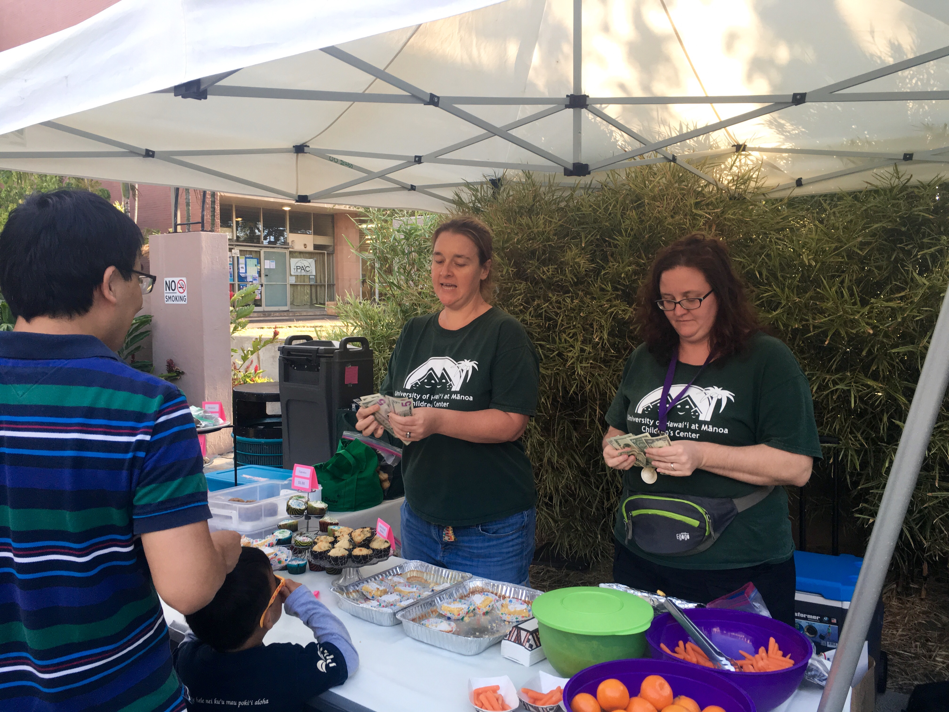 aunty valley & aunty heather l. selling baked goods