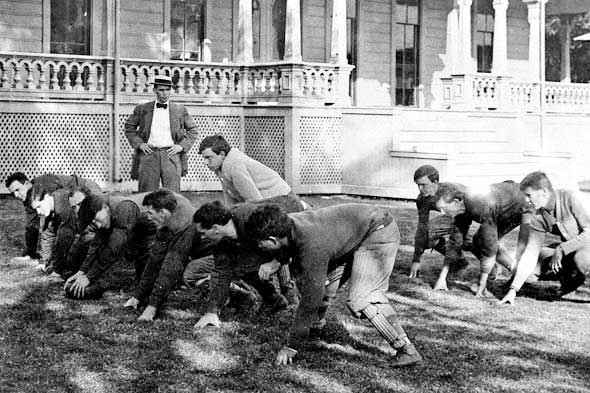 men playing football in 1920s