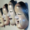 Close up of gallery display of noh and kyogen masks at the East-West Center