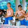 shirtless men making drink
