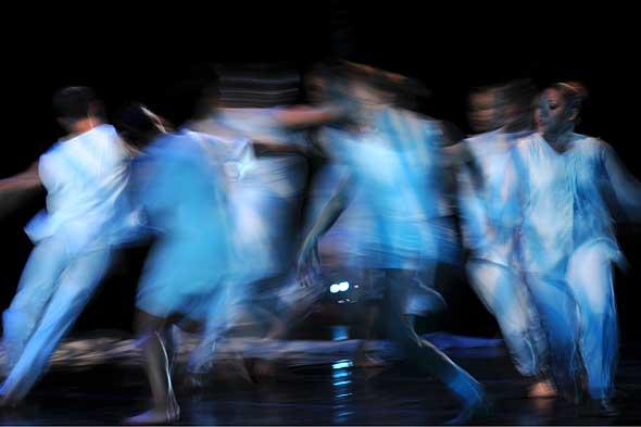blurred dancers in white