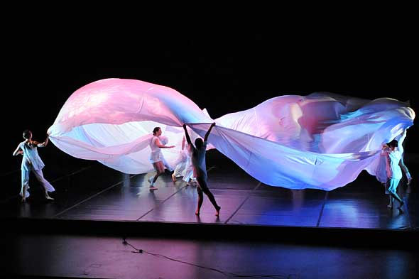 dancers with large white fabric swaths