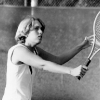 tennis player Sue Black takes a swing