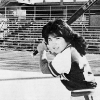 female softball player at bat