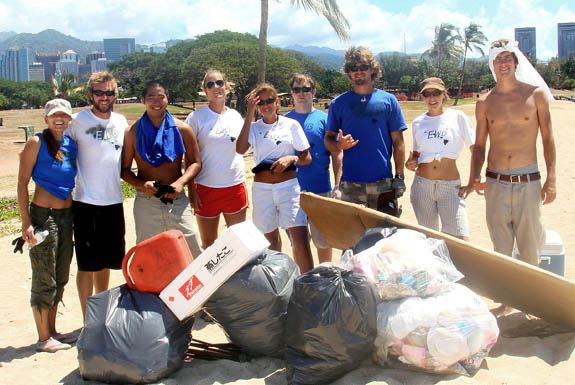 Engineering students at a beach clean-up service project