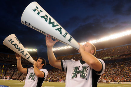 male University of Hawaii at Manoa cheerleaders with megaphones