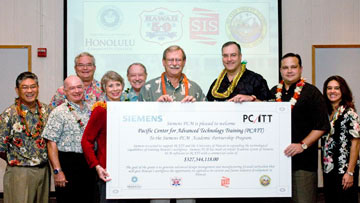 PCATT Director Scott Murakami, far left, with Michael Rota and Ramsey Pederson from Honolulu Community College; UH Foundation President Donna Vuchinich; university executives John Morton and David McClain receive the software donation from Siemens officials Mike Schwind, Matt Brennan and Diane Ryan