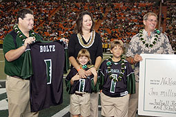 Athletic Director Jim Donovan, left, with the Bolte family