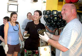scientists with sediment samples collected from the Mariana Trench by Nereus; photo by Barbara Fletcher, U.S. Navy