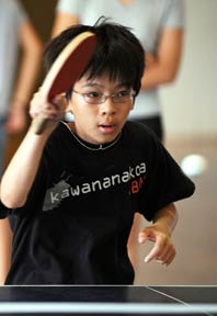 boy playing ping pong