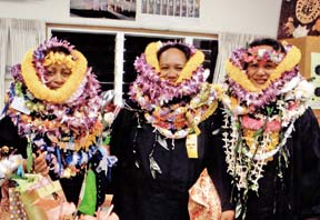 college graduates with many lei