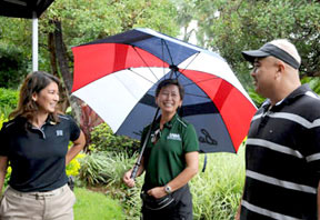 golfers under rain umbrella