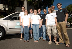 group shot of educators with the van donated to move the Starlab planetarium