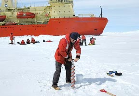 Craig Smith uses a Kovacs Ice Corer to take an ocean water sample.