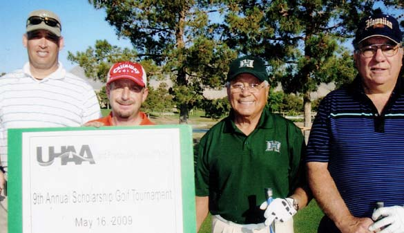 golfers with a giant check