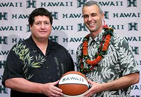 Jim Donovan and Gib Arnold holding a basketball