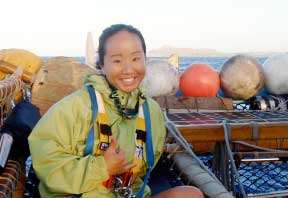 Linda Furuto on the voyaging canoe Hokulea
