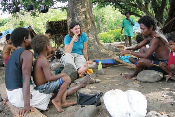 Western researcher visiting with Negrito tribespeople