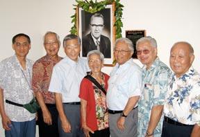 group shot around the installed Edward Ross portrait