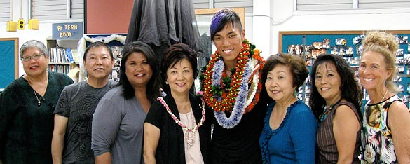 Two people in lei flanked by several others