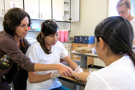 students with an instructor practicing nursing care
