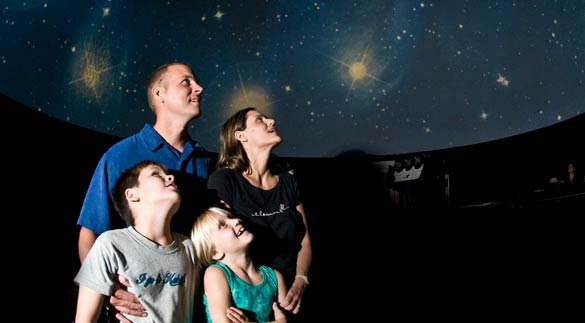 family looking skywards in Imaginarium
