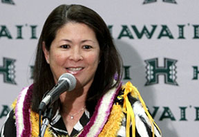 Rainbow Wahine soccer head coach Michele Nagamine at a press conference, with lei