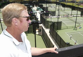 coach overlooking tennis courts