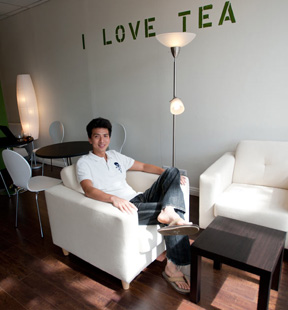 Ervin Gong sitting in The Tea Farm cafe