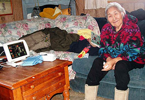Alaskan woman at home on her computer