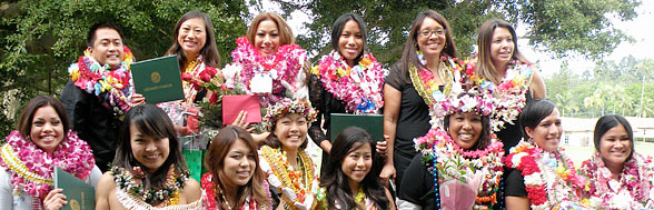 group shot of nursing school graduates with lei on