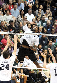 volleyball player going up for a spike