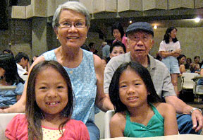 Grandparents with grandchildren in a movie auditorium