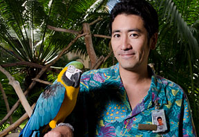 Kevin Murata holding a macaw