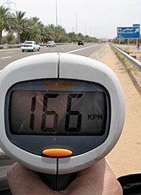 speedometer showing 166 kilometers per hour
