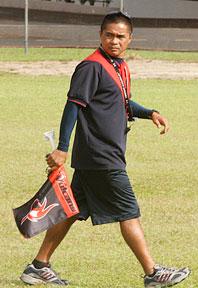 Coach Jaime Guerpo on grassy field