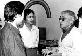 Albert Parvin talking to two Chinese journalists