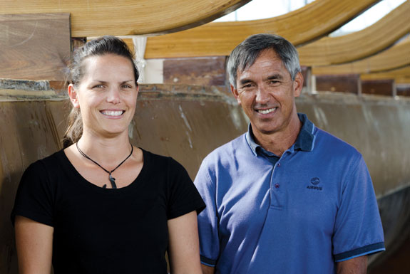 Kaiulani Murphy and Nainoa Thompson in front of the Hokulea voyaging canoe