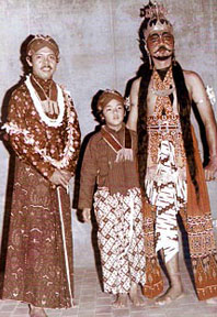 Two men and boy in Indonesian theater costuming