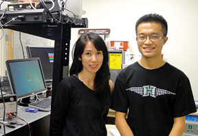 students Kelly Ishii and Wenqi Hu in microrobotics laboratory