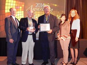 Failautusi Avegalio (center), Director of UH's Pacific Business Center Program with award