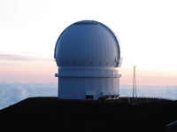 Canada-France-Hawaii Telescope against pink-tinged sky