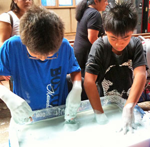two boys playing with goo