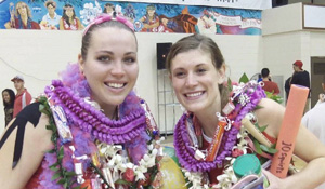 Two women volleyball players with lei
