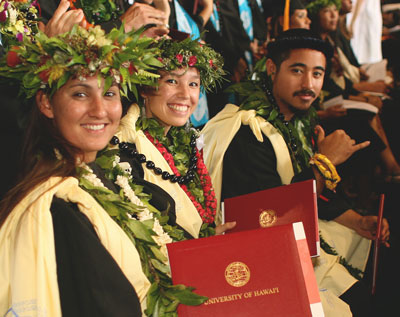 Students with lei at commencement