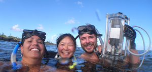 Three people in dive gear in water