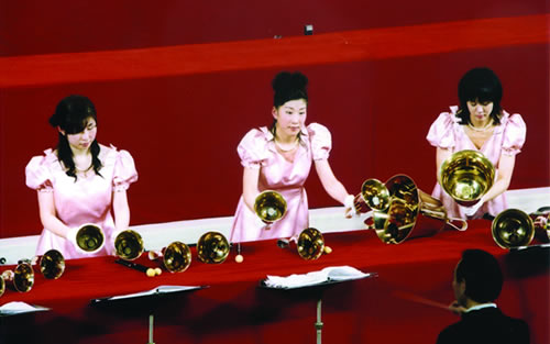 women playing handbells