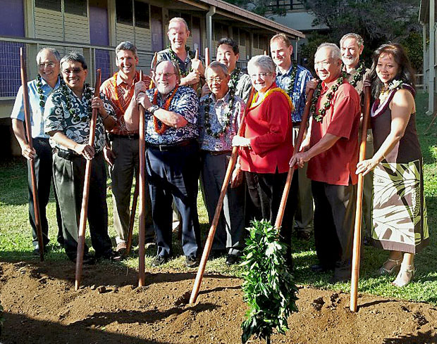 Group of people wearing lei holding oo, Hawaiian digging sticks
