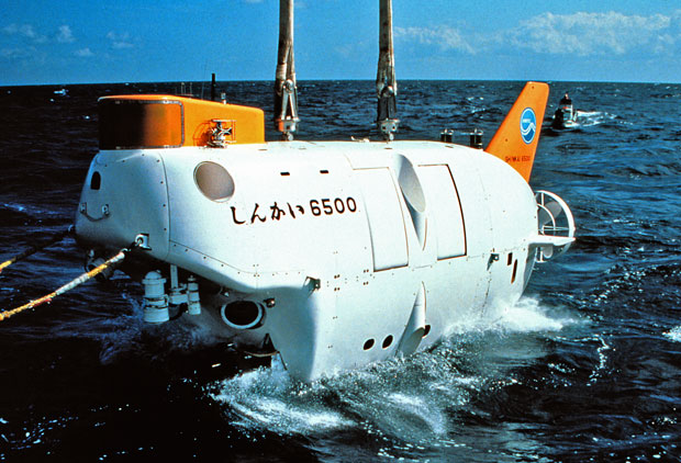 white submersible being lifted from water