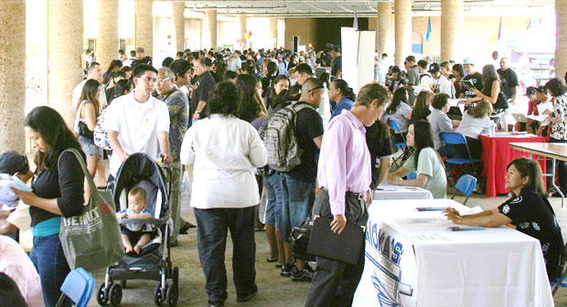 A crowd of people at a job fair